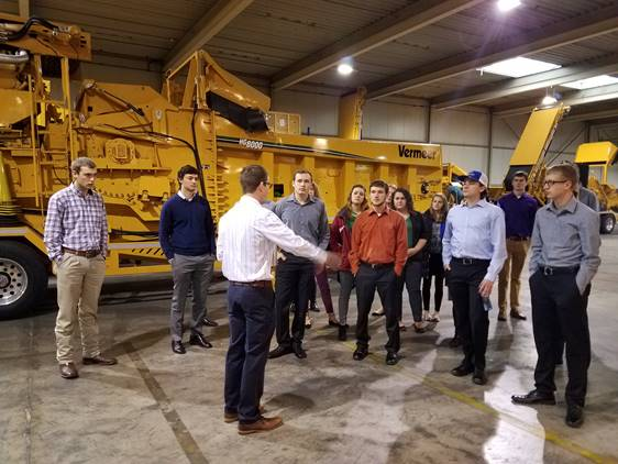 2016-17 cohort touring the Vermeer facility in Goes, Netherlands during their January 2017 trip.